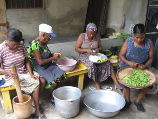 women cutting veggies