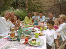 Group of people at lunch table outdoors