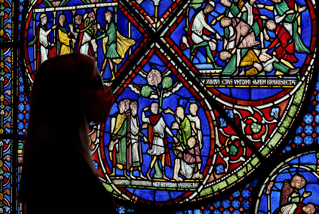 The Miracle Window in the Becket Exhibition with a person in front