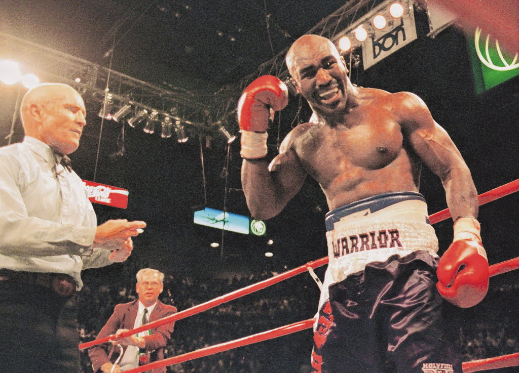 3948772 bytes; 2000 x 1441; 28 Jun 1997: Evander Holyfield complains to referee Mills Lane after Mike Tyson bit the top of his e