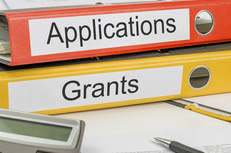 binders that say applications and grants