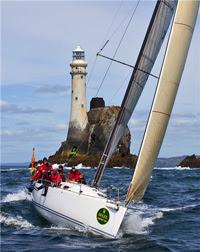 J/122 sailing off Fastnet Rock Lighthouse- Rolex Fastnet Race