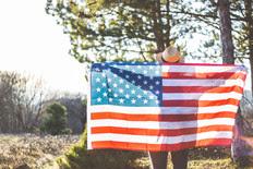 Man draped in U.S. flag.