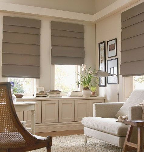 Hobbled roman shades have more structure, retain the horizontal element even when they're down. It's a choice.: