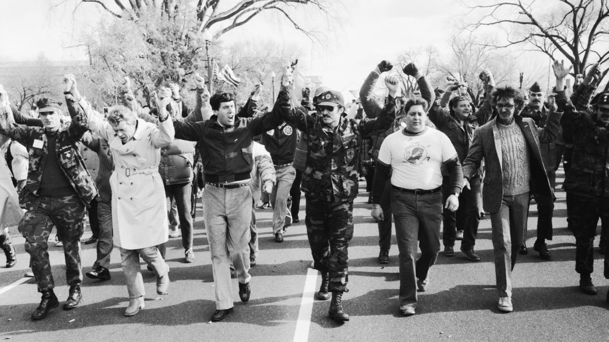 In 1982 Vietnam veterans march down Constitution Avenue toward the Vietnam Veterans Memorial, which would be dedicated later that day.