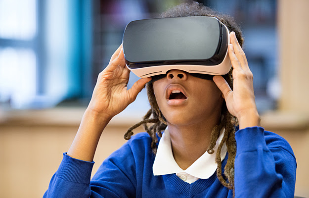 A young girl wearing a virtual reality headset.