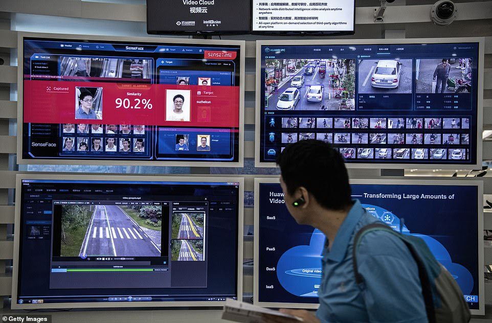 A display for facial recognition and artificial intelligence is seen on monitors in one of the offices