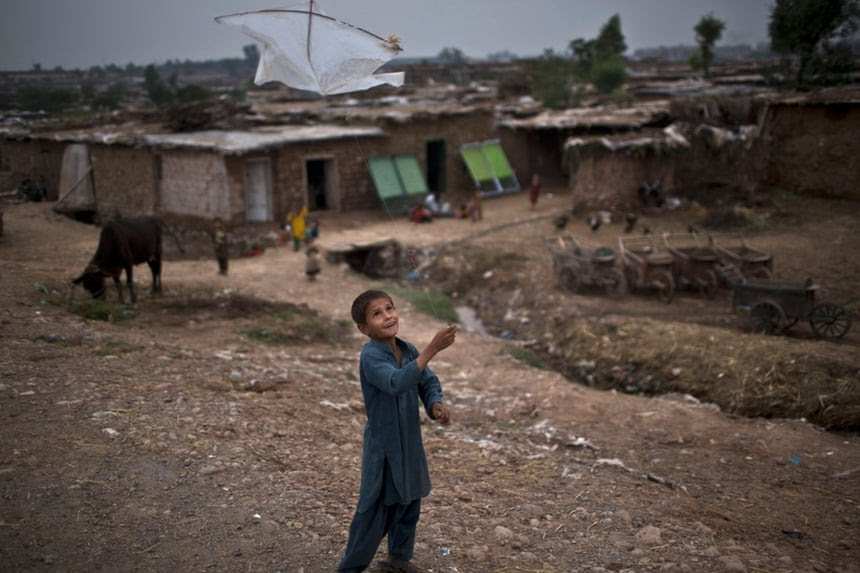 An Afghan refugee child plays with a kite