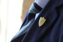 school tie and prefect badge