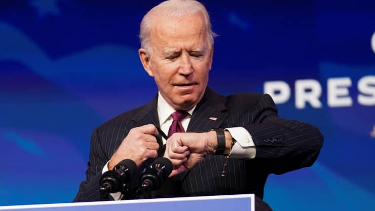 Joe Biden looking at his watch