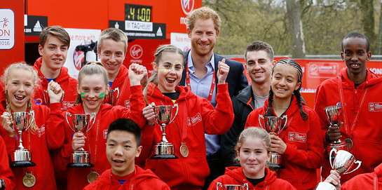 Prince Harry with winners of the 2016 Virgin Money London Marathon