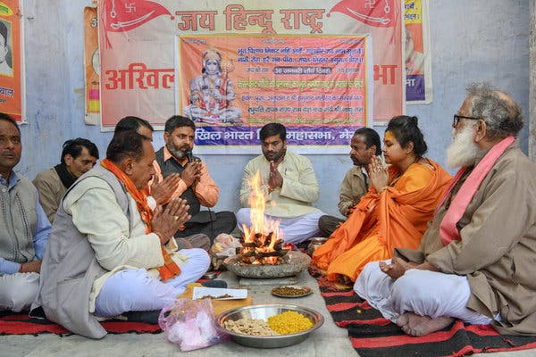 Pooja Shakun Pandey, second from right, during a ceremony worshiping Mr. Godse in Meerut.
