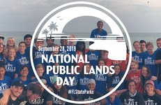 National Public Lands Day banner and photo of volunteers