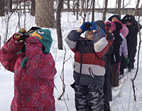 Children looking through binoculars by Susan Hobart