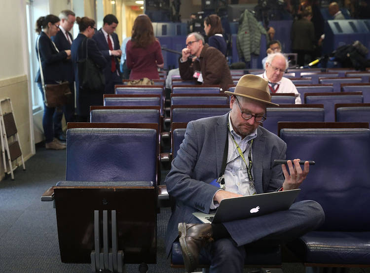 New York Times reporter Glenn Thrush works in the White House briefing room. (Mark Wilson/Getty Images)