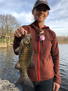 Angler with smallmouth bass