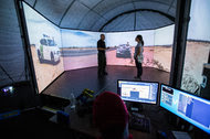 Jason Daniels, an agent with the United States Border Patrol, instructing Fernanda Santos last week during a virtual reality exercise in Tucson.