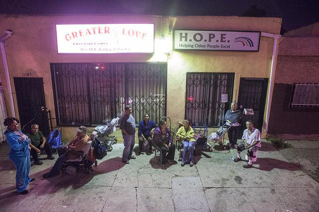 Charles on the wheel chair, Daphne wearing blue, Paloma, Hilda, and Nora sitting at the center, 11165 S. Central Ave., LA, 2014