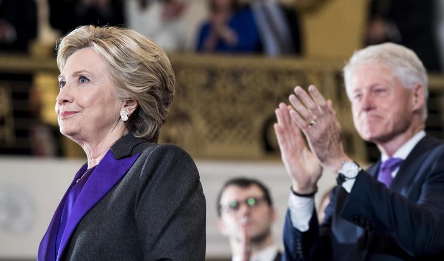 A mensagem poderosa por trás lapelas roxo de Hillary Clinton