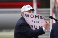 Donald J. Trump with a sign while speaking at a campaign rally at the Lakeland Linder Regional Airport on Wednesday in Lakeland, Fla.