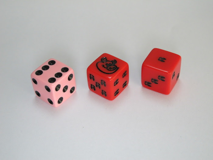 Piggy dice (one black and one pink)