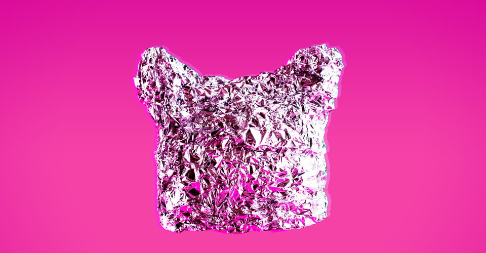 A tin foil hat on a bright pink background